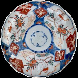 Imari Japon porcelain plate decorated with landscape, flowers, hare and cornucopia.