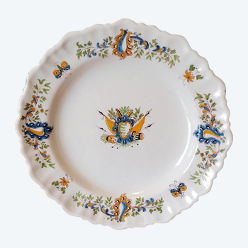 Earthenware plate: Moustiers 18th century.
