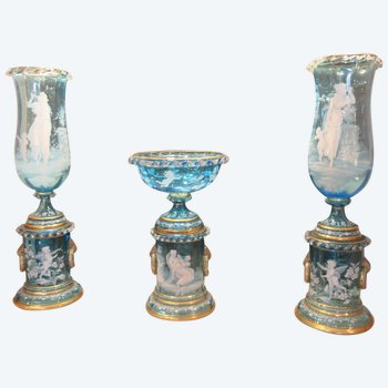Mary-Gregory Fireplace set with enamelled decoration on a blue glass background