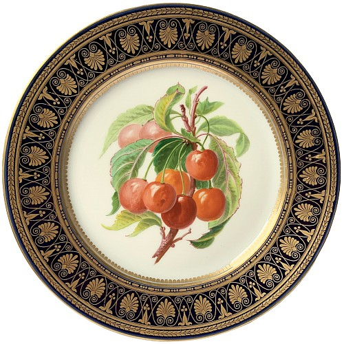 Plate with polychrome and gold decoration decorated with cherry fruits in the taste of Sèvres