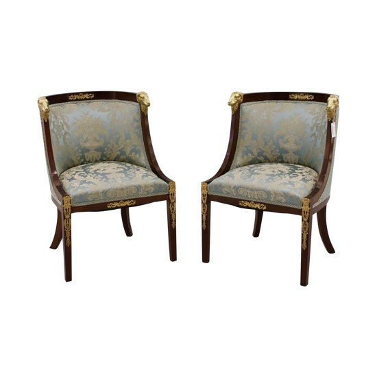 A pair of armchairs in the empire style